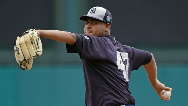 New York Yankees' Ivan Nova pitches in the first inning against the Atlanta Braves in a spring training baseball game, Wednesday, March 30, 2016, in Kissimmee, Fla.