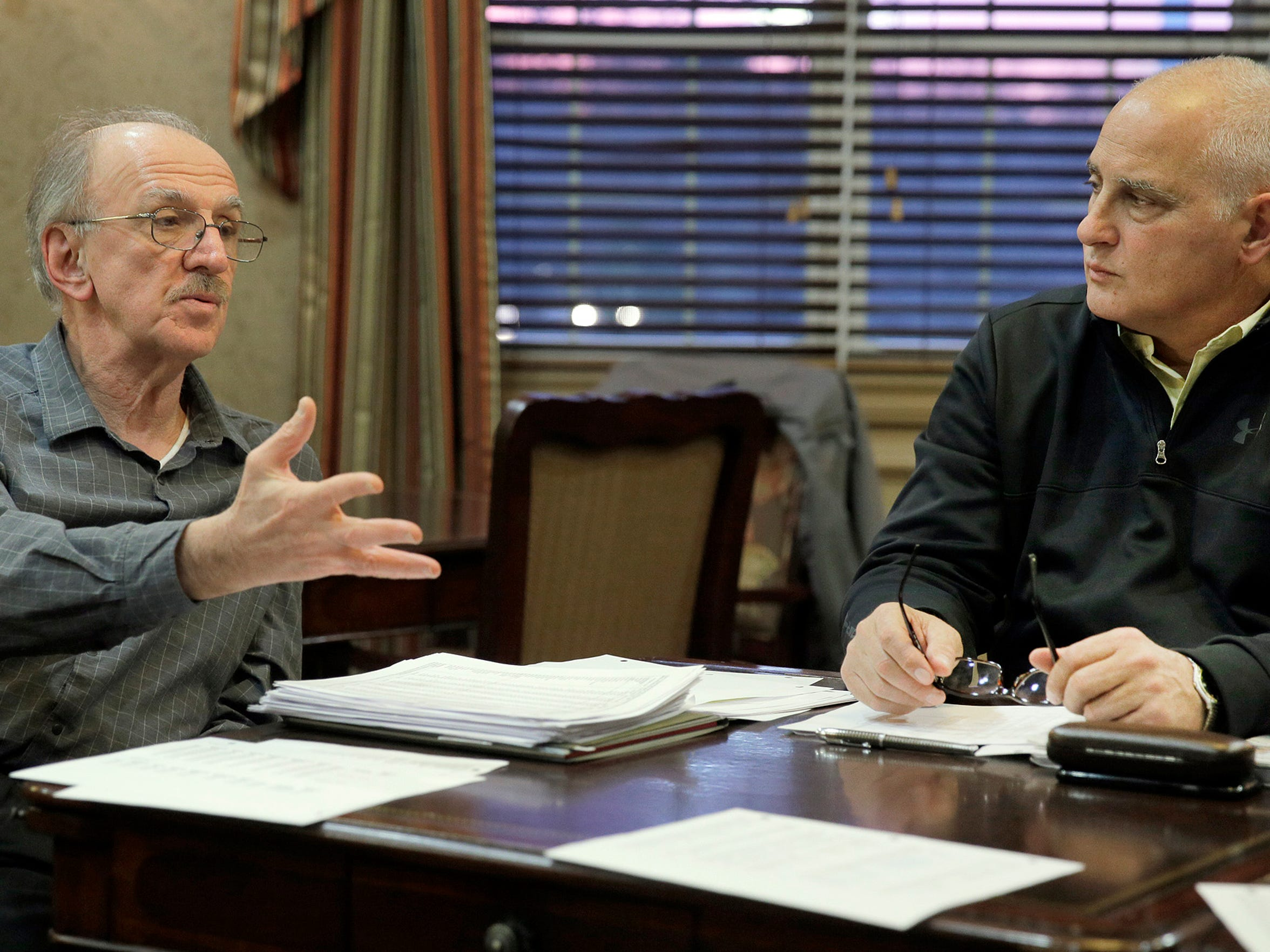 Adam Seyhan (left) and Richard Nocerino are among the group that gathered at the Equestra clubhouse in Howell Township Thursday evening, January 14, 2016, who are trying to fight back against increasing property taxes.