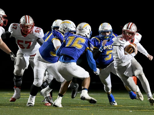 Shelby's Adrian Hall finds room to run against the Philo defense Friday night at Westerville North High School.