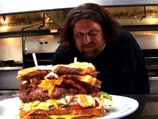 Chef Aaron May with the Sasquatch burger at The Lodge in Scttsdale.