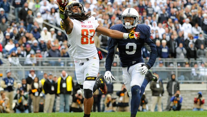 Maryland wide receiver Marcus Leak (82) reaches for a pass that would fall incomplete in front of Penn State Nittany Lions cornerback Jordan Lucas (9) during the fourth quarter at Beaver Stadium.  Maryland defeated Penn State 20-19.