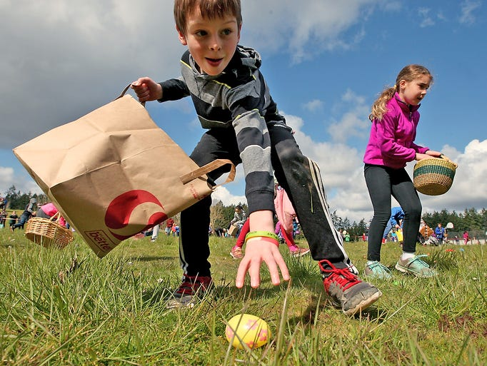 Liam Barry, 8, grabs a plastic egg as he quickly makes