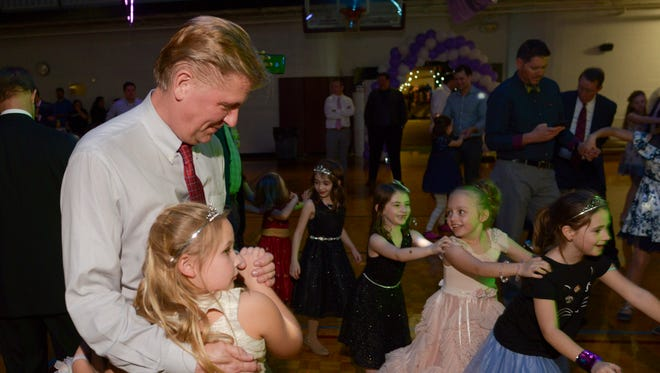Jim Wrye dances with his daughter Ella, 8, at the Father Daughter Dance at the Franklin Recreation Complex on Saturday.