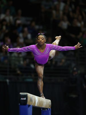 Simone Biles of the United States competes on the balance beam during Day 2 of the 2016 Pacific Rim Gymnastics Championships at Xfinity Arena on April 9, 2016 in Everett, Washington.  Biles won the all-around competition.