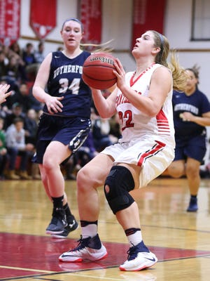 Glen Rock senior forward Kelly Lohr attempts a shot in the Panthers' 49-27 win over Rutherford on Thursday night. Lohr finished with a game-high 17 points.