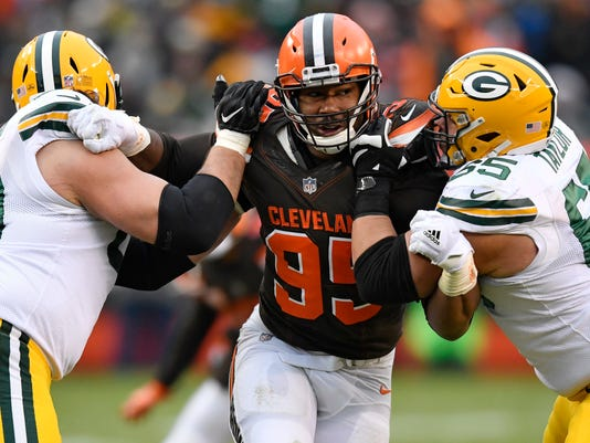 Cleveland Browns defensive end Myles Garrett, center, squeezes between Green Bay Packers offensive tackle David Bakhtiari, left, and offensive guard Lane Taylor in the second half of an NFL football game, Sunday, Dec. 10, 2017, in Cleveland. The Packers won 27-21 in overtime. (AP Photo/David Richard)