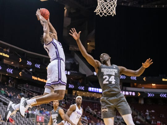 Kansas State forward Xavier Sneed (20) shoots over Mississippi State forward Abdul Ado (24) during the first half of the Never Forget Tribute Classic NCAA college basketball game, Saturday, Dec. 14, 2019, in Newark, N.J. (AP Photo/Corey Sipkin)