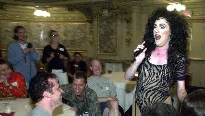 Wayne Smith of Dallas works the crowd at the Cher Convention on Friday in Chicago.-