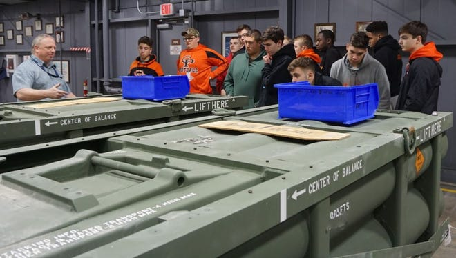 Ed Johnson, a Letterkenny Munitions Center supervisor, explains Multiple Launch Rocket System Family of Munitions maintenance processes to U.S. Air Force JROTC cadets from Cathedral Preparatory School, Erie, during their tour of LEMC facilities.