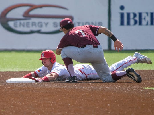 UL's Daniel Lahare slides onto second base during the Ragin' Cajuns'  9-7, 11-innings loss to Little Rock on Sunday at The Tigue.