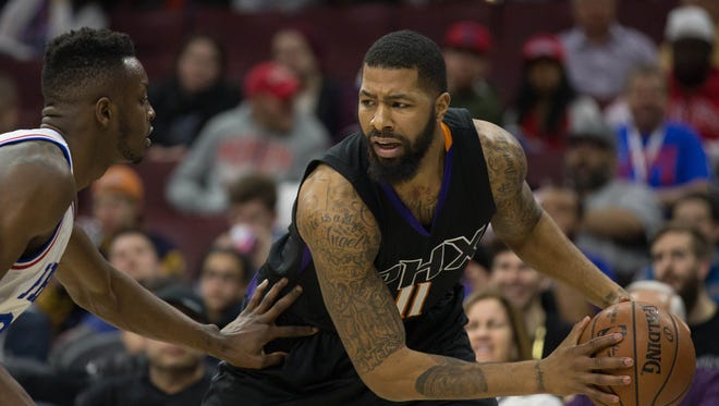 Suns forward Markieff Morris (11) looks for an opening past Philadelphia 76ers forward Jerami Grant (39) during the second half at Wells Fargo Center.