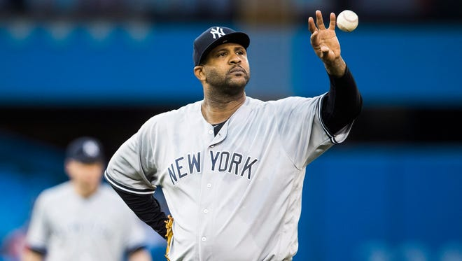 New York Yankees piticher CC Sabathia catches the ball during the fourth inning of the team's baseball game against the Toronto Blue Jays on Tuesday, May 31, 2016, in Toronto.
