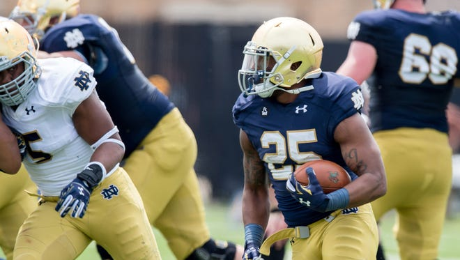 Notre Dame Fighting Irish running back Tarean Folston (25) runs in the first quarter of the Blue-Gold Game at the LaBar Practice Complex.