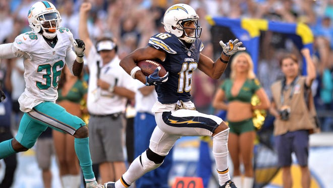 Nov 13, 2016; San Diego, CA, USA; San Diego Chargers wide receiver Tyrell Williams (16) runs for a touchdown after a catch as Miami Dolphins cornerback Tony Lippett (36) gives chase during the fourth quarter at Qualcomm Stadium. Mandatory Credit: Jake Roth-USA TODAY Sports