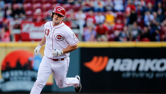 Cincinnati Reds right fielder Scott Schebler (43) rounds the bases after hitting a solo home run in the second inning during the interleague baseball game between the Cleveland Indians and the Cincinnati Reds, Monday, May 22, 2017, at Great American Ball Park in Cincinnati.