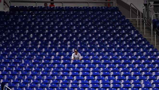 Sep 6, 2017; Miami, FL, USA; A fan sits in the left field stands during the game between the Miami Marlins and the Washington Nationals at Marlins Park. Mandatory Credit: Jasen Vinlove-USA TODAY Sports