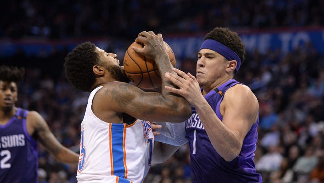 Mar 8, 2018; Oklahoma City, OK, USA; Oklahoma City Thunder forward Paul George (13) drives to the basket against Phoenix Suns guard Devin Booker (1) during the second quarter at Chesapeake Energy Arena. Mandatory Credit: Mark D. Smith-USA TODAY Sports