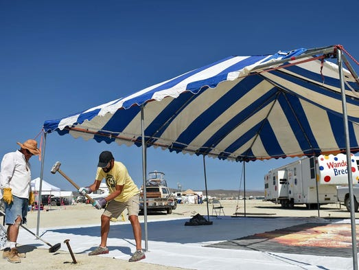 Images of artists and volunteers setting up for the annual Burning Man event on the Black Rock Desert of Gerlach, Nevada on August 23, 2014.