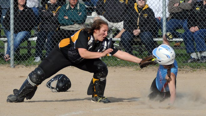 Algoma catcher Andy Vandertie tags out Southern Door runner Gabby Atkins during Monday's game at Southern Door.