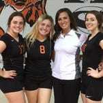 Members of the Opelousas High volleyball team Morgan Booksh, Miranda Menard, Coach Kelsie Soileau and Ashley Thibodeaux are shown after the team defeated Carencro 3-0 in the final OHS home match of the season.