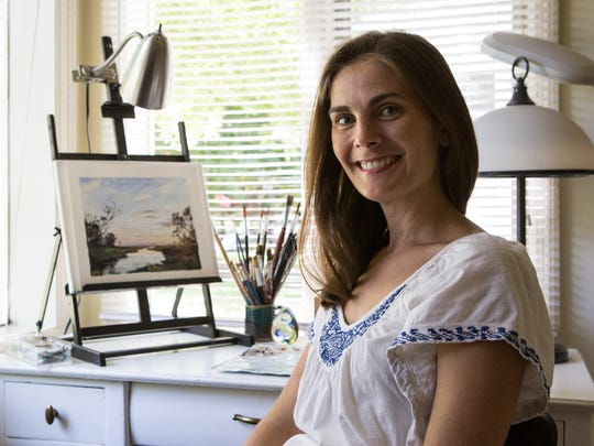 Rachel Alvarez, a local artist, poses for a photo at her home studio on Tuesday, July 25, 2017.
