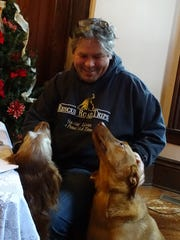 Greg Mahle doesn't consider himself a hero, but his canine friends, all rescue dogs, seem to think he is.