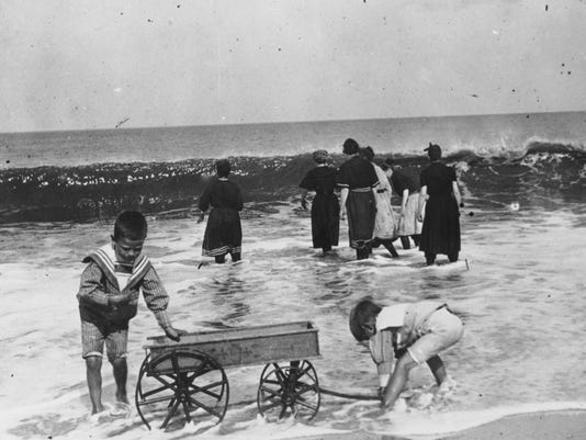 636670981842487038-9015-Purnell-Coll-11412pn-boys-with-wagon-at-beach-early-1900-s.jpg