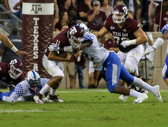 Chris Oats records a sack in Saturday's game at Texas A&M.