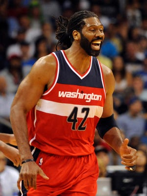 Nene had 12 points in his season debut after missing the Wizards' opener.