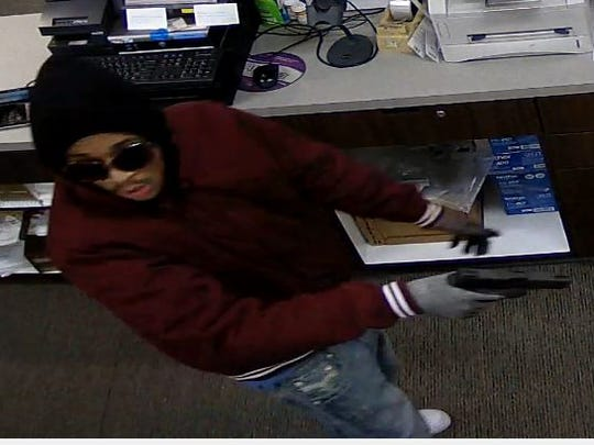 A suspect in an armed robbery of Swan Pharmacy, 9130