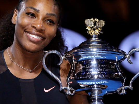 FILE - In this Jan. 28, 2017, file photo, United States' Serena Williams holds her trophy after defeating her sister Venus during the women's final at the Australian Open tennis championships in Melbourne, Australia. Williams and Alexis Ohanian got married at the Contemporary Arts Center in New Orleans, according to a story and photos posted on Vogue's website on Friday night, Nov. 17, 2017. Vogue said the celebrity guests at Thursday's ceremony included Beyonce and Kim Kardashian West. (AP Photo/Aaron Favila, File)