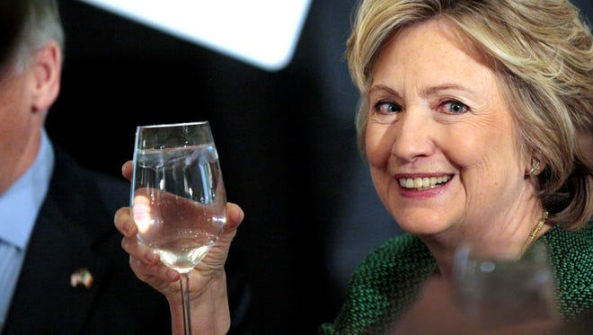 Hillary Clinton raises her glass during a toast at a ceremony to induct her into the Irish America Hall of Fame on March 16, 2015, in New York City.