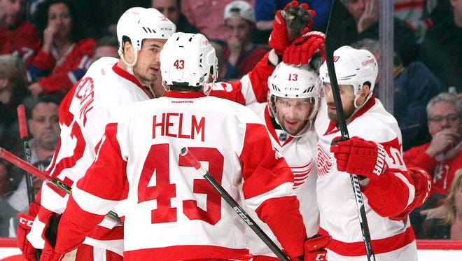 Detroit Red Wings center Pavel Datsyuk celebrates his goal against Montreal Canadiens with teammates at Bell Centre.