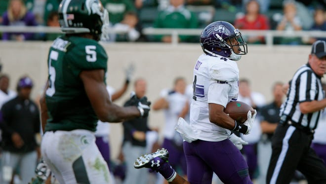 Northwestern's Solomon Vault returns a kickoff 95 yards for a touchdown against Michigan State.