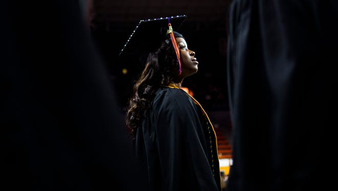 Students file into the arena at the start of Clemson's winter graduation on Thursday, December 15, 2016 in Littlejohn Coliseum.