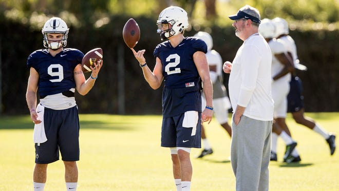 Penn State quarterbacks Trace McSorley and Tommy Stevens wait with offensive coordinator Joe Moorhead during football practice, Thursday, Dec. 29, 2016 in Carson, Calif. Penn State will take on Southern California in the Rose Bowl on Jan. 2, 2017.  (Joe Hermitt/PennLive.com via AP)