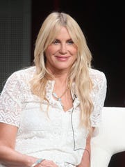 Daryl Hannah tells 'The New Yorker' she once barricaded herself in a hotel room to fend off Harvey Weinstein.