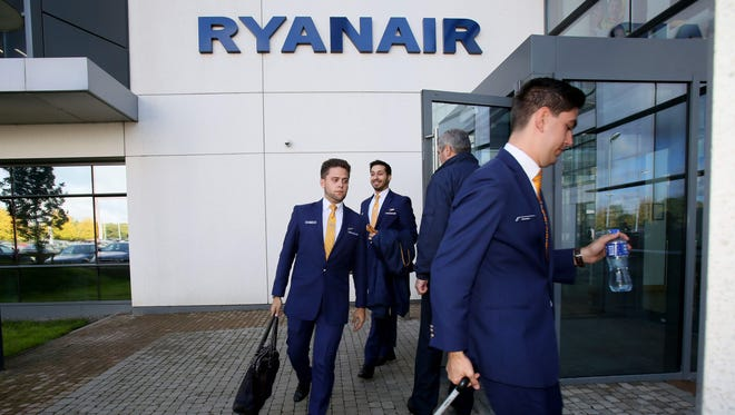 Staff leave Ryanair headquarters in Dublin on Sept. 21, 2017. Ryanair CEO Michael O'Leary said on Thursday that he could not rule out axing more flights, but added any additional cancellations would not be linked to ongoing pilot scheduling problems.