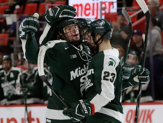 Michigan State defenseman Carson Gatt, facing camera,