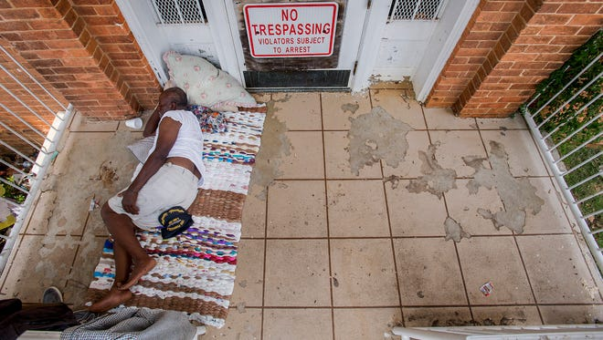 Willie Love takes a nap on the porch of the Chappell House on Maxwell Blvd in Montgomery, Ala., on Thursday July 19, 2018.