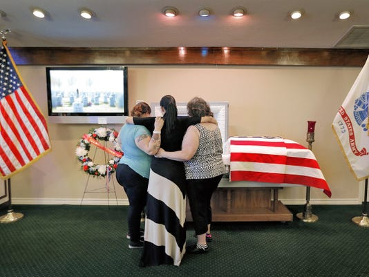 MARK LAMBIE -EL PASO TIMES Family and friends of World WWII veteran Harry Steen Sr. said goodbye to the Bataan Death March survivor Tuesday evening at Sunset Funeral Home in east El Paso. Steen