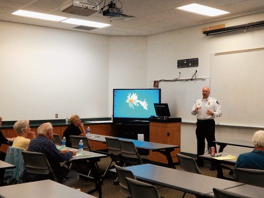 Ruidoso Fire Chief Harlan Vincent during the Forest Health talk on ISO and its rating system.