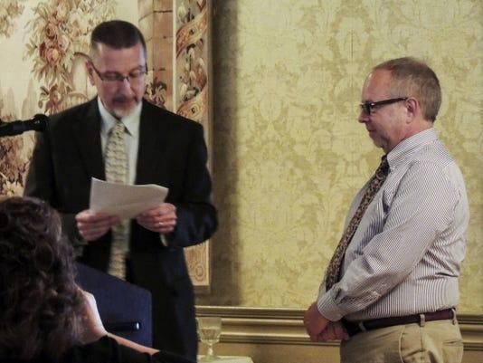 Bill Wertz, president of Wertz Candies, receives Small Business Person of the Year award Thursday.