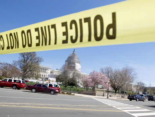 U.S. Capitol Police and other emergency services respond Saturday to the U.S. Capitol in Washington. Police say the U.S. Capitol is on lockdown as a precaution after shots were fired in what appears to be an attempted suicide.