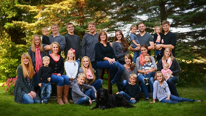 The Seibel family includes Amy and Tom Seibel, their 12 children, three sons-in-law and seven grandchildren.