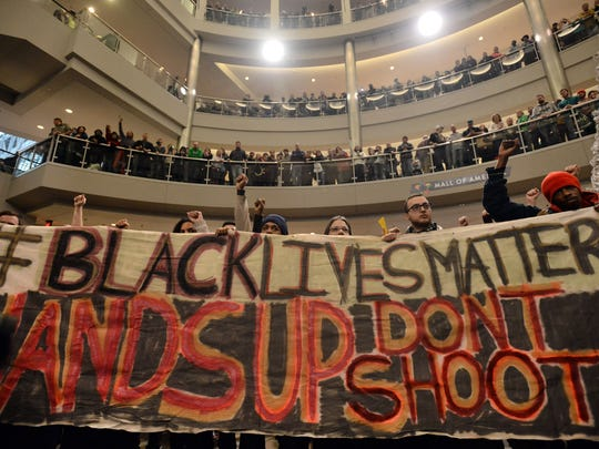 "Demonstrators fill the Mall of America rotunda, chanting ""Black lives matter"" to protest police brutality in Bloomington, Minn."