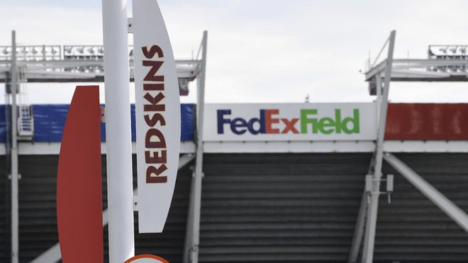 Signs for the Washington Redskins are displayed outside FedEx Field in Landover, Md. on Monday.