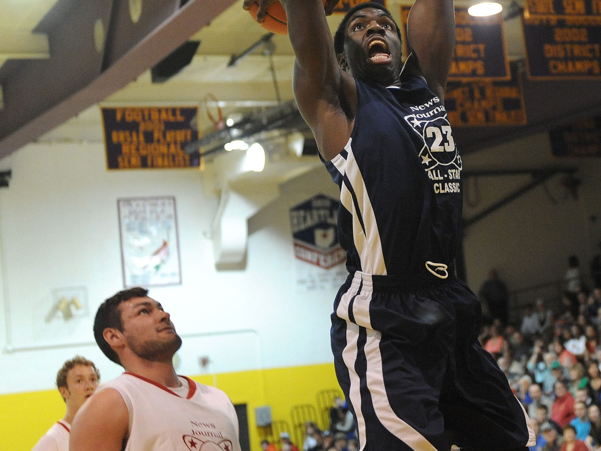 Tyrell Edmiston dunks the ball during the 37th annual News Journal All-Star Basketball Classic at Lexington High School.