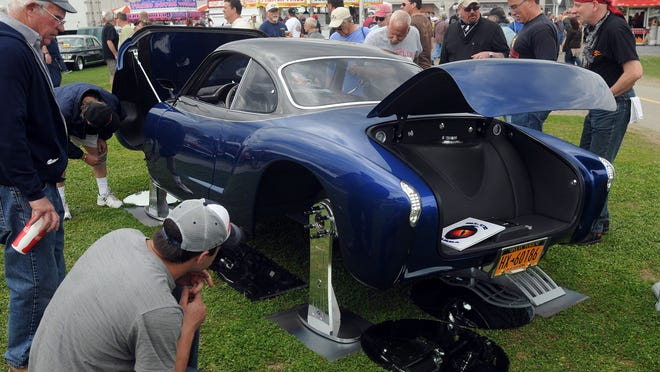 Visitors at the 2014 Rhinebeck Car Show on Saturday check out the Blue Mamba, a 1967 Karmann Ghia outfitted with a 650-horsepower, 10-cylinder Dodge Viper engine. Standing at far left is Jim McPerson of New Jersey.