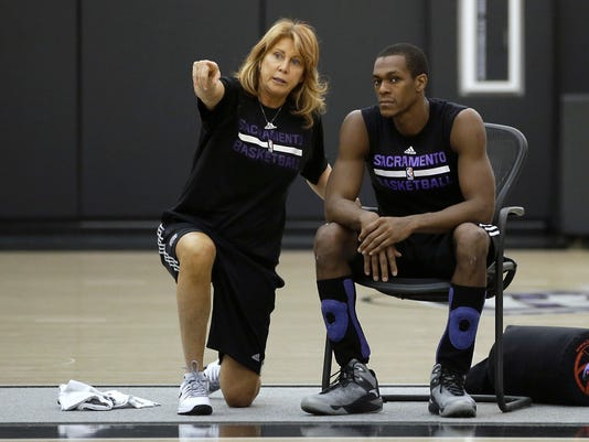 FILE - In this Oct. 26, 2015, file photo, Sacramento Kings assistant coach Nancy Lieberman talks with guard Rajon Rondo during NBA basketball practice in Sacramento, Calif. Lieberman, a Hall of Famer, will coach a team this season in the BIG3, the league announced Wednesday, March 21, 2018. Lieberman, one of women's basketball's star players who has gone on to coach in the NBA, WNBA and NBA Development League, will lead Power. She replaces Clyde Drexler, who recently accepted a job as commissioner of the 3-on-3 league of former NBA players. (AP Photo/Rich Pedroncelli, File)